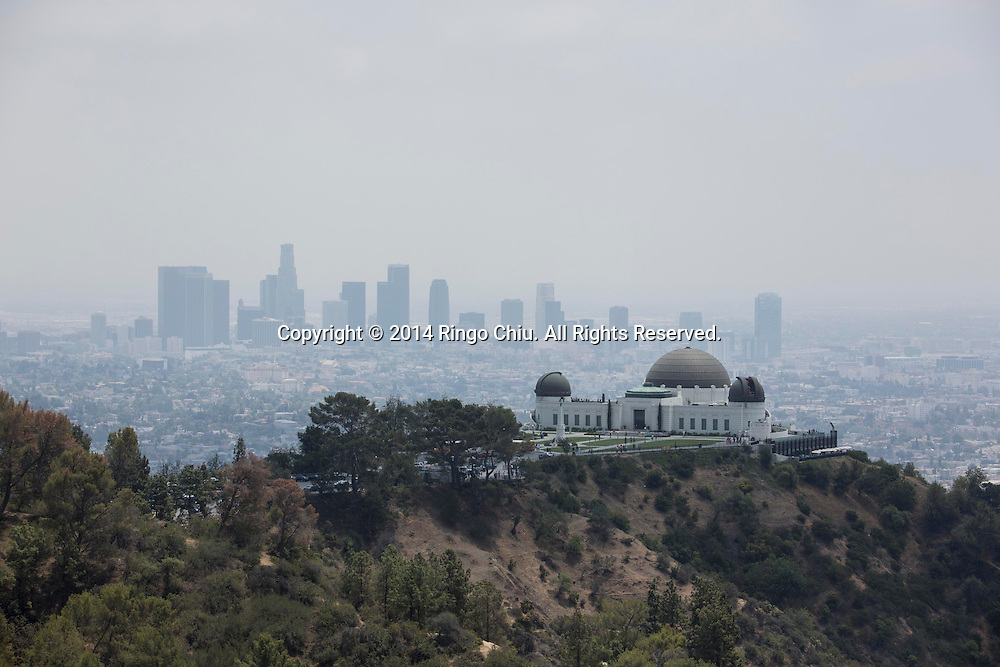 Downtown Los Angeles skyline is seen behind the Griffith Observatory  from the Griffith Park in Los Angeles, California, Friday, May 23, 2014. Griffith Park is a large municipal park at the eastern end of the Santa Monica Mountains in the Los Feliz neighborhood of Los Angeles, California. The park covers 4,310 acres of land, making it one of the largest urban parks in North America.(Photo by Ringo Chiu/PHOTOFORMULA.com)