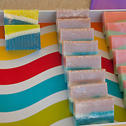 A colorful display of artisan hand soaps made by Maria McQuaid of Wicker Good Soap Co.