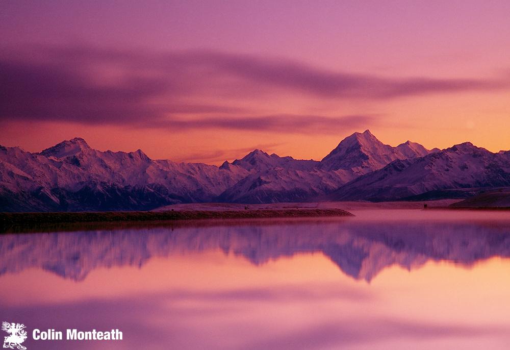 Winter dawn reflection across Lake Pukaki, looking towards Mt Sefton (left) & Aoraki Mount Cook, Southern Alps, New Zealand