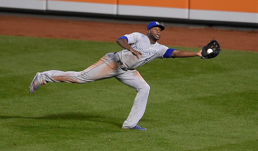 Kansas City Royals center fielder Lorenzo Cain makes a catch Baltimore Orioles shortstop J.J. Hardy during the sixth inning in the American League Championship Series playoff baseball game on October 11, 2014 at Camden Yards in Baltimore, Md.