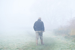 © under license to London News Pictures.  15/11/2010 A man goes for an early walk this morning (monday), surrounded in dense fog that covered a large part of the worcestershire countryside. Picture credit should read: David Hedges/London News Pictures