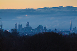 """Distant clouds are seen over south east London. The threatened snow from """"The Beast From The East"""" weather system doesn't materialise overnight in London leaving a crisp, clear morning, seen from Hampstead Heath in North London. London, February 27 2018."""