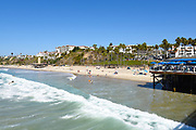 Coastline of Surfers and Sunbathers Seen From the Pier in San Clemente
