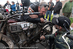 Team Vino mechanics Chrys Miranda of Brazil and Big Swede (you guessed it, of Sweden) work on Dean Bordigioni's 's bike. Motorcycle Cannonball coast to coast vintage run. Stage 12 (242 miles) from Great Falls to Kalispell, MT. Thursday September 20, 2018. Photography ©2018 Michael Lichter.
