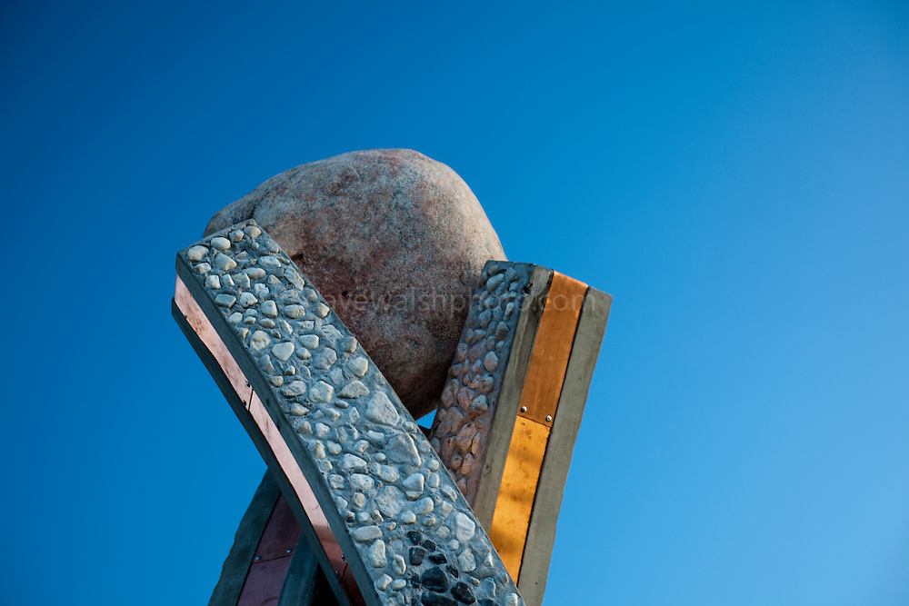 Inussuk, a sculpture by Niels Motfeldt, in Nuuk, Greenland, marking the start of Self Governance on June 21, 2009. The three pillars refer to the three peoples of Greenland, north west and east. The stones were collected from the shores of Greenland.
