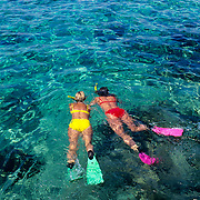 Two woman in bikini snorkeling in Cozumel. Quintana Roo, Mexico