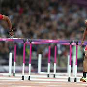 Aries Merritt, USA, (left) wins the Gold Medal from team mate  Jason Richardson, USA, in the Men's 110m Hurdles Final at the Olympic Stadium, Olympic Park, during the London 2012 Olympic games. London, UK. 8th August 2012. Photo Tim Clayton