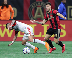 March 11, 2018 - Atlanta, GA, USA - Atlanta United forward Hector Villalba wins the battle for the ball with D.C. United player Ulises Segura during the second half on Sunday, March 11, 2018, in Atlanta, Ga. Atlanta United won the game 3-1. (Credit Image: © Curtis Compton/TNS via ZUMA Wire)