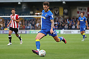 AFC Wimbledon defender Callum Kennedy (23) dribbling and about to pass the ball during the EFL Cup match between AFC Wimbledon and Brentford at the Cherry Red Records Stadium, Kingston, England on 8 August 2017. Photo by Matthew Redman.
