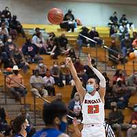 Gallup Bengal Khohanon Atazhoon (23) shoots a three-pointer against the Bloomfield Bobcats Tuesday evening at Gallup High School in Gallup.