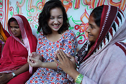 Louiza Zhang (AYAD) from NEWAH Research and Documentation Support Office talks with a group of women in Ganespur Community of Bastipur NEWAH WASH project Siraha, Udayapur District, Nepal.