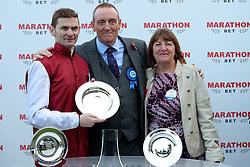 Robert Havlin (left) with the trophy after winning the Marathonbet November Handicap race during Marathonbet November Handicap Day at Doncaster Racecourse.