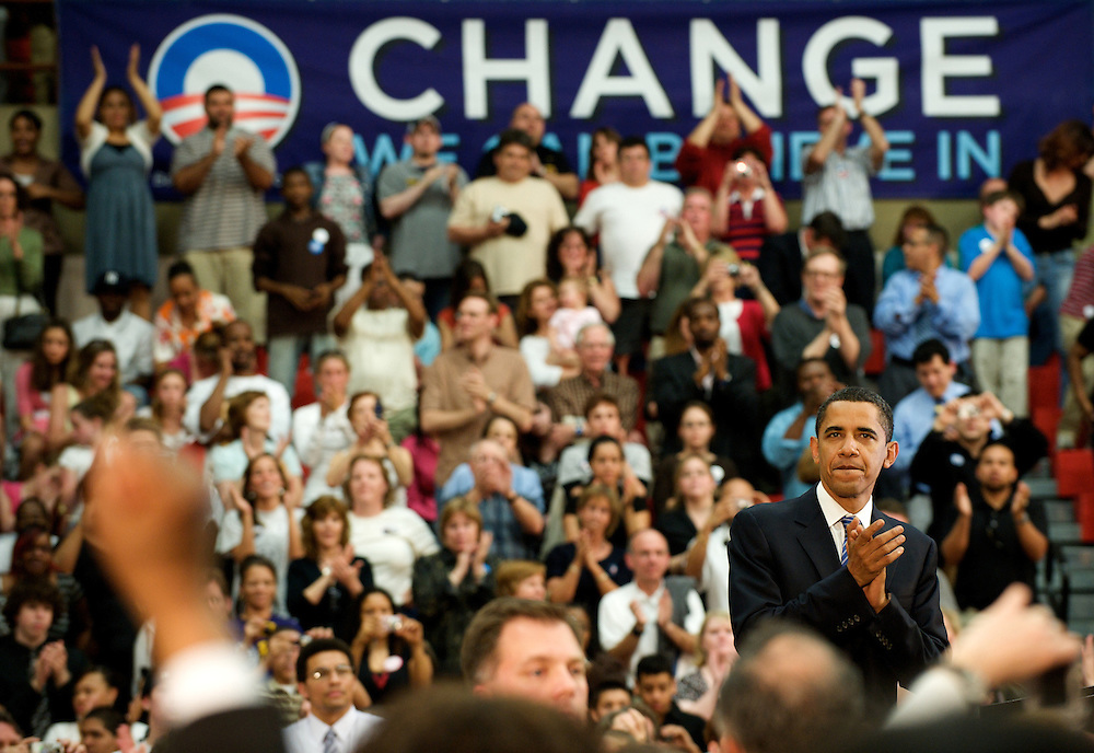 Senator Barack Obama reacts to crowd applause at a Reading High School campaign rally in Pennsylvania.