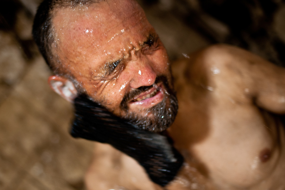 A coal miners bathes after a shift at the Karkara Coal Mine, one of Afghanistan's only industrial-scale working mines, near the town of Pul-e-Khumri.