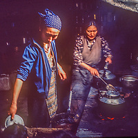 Proprietors Dawa and Namdu Sherpani prepare a meal in the kitchen of Khumbu Lodge in Namche Bazaar, the leading town of Nepal's Sherpa people.