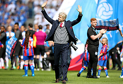 Arsenal manager Arsene Wenger waves to the fans as the match begins