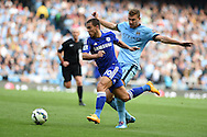 Chelsea's Eden Hazard breaks away from Man city's Edin Dzeko. . Barclays premier league match, Manchester city v Chelsea at the Etihad stadium in Manchester,Lancs on Sunday 21st Sept 2014<br /> pic by Andrew Orchard, Andrew Orchard sports photography.