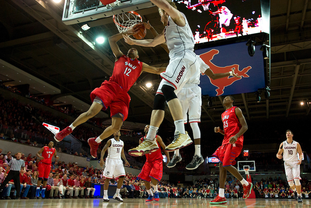 DALLAS, TX - JANUARY 4: Nick Russell #12 of the SMU Mustangs drives to the basket against the Connecticut Huskies on January 4, 2014 at Moody Coliseum in Dallas, Texas.  (Photo by Cooper Neill) *** Local Caption *** Nick Russell