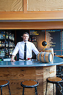 Barrel-aged cocktails made by Clyde Common's restaurant bartender, Jeffery Morgenthaler, in Portland, Oregon.  Pictured here is Jeffery at the bar in Clyde Common serving up a barrel-aged Negroni cocktail.