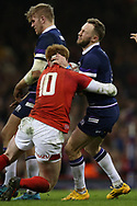 Byron McGuigan of Scotland is stopped by Rhys Patchell of Wales. Wales v Scotland, NatWest 6 nations 2018 championship match at the Principality Stadium in Cardiff , South Wales on Saturday 3rd February 2018.<br /> pic by Andrew Orchard, Andrew Orchard sports photography