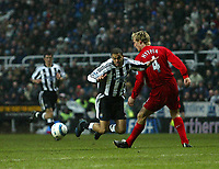 Photo. Andrew Unwin, Digitalsport<br /> Newcastle United v Liverpool, Barclays Premiership, St James' Park, Newcastle upon Tyne 05/03/2005.<br /> Newcastle's Kieron Dyer (C) tumbles as he looks to go past Liverpool's Sami Hyypia (R), but no foul is awarded.