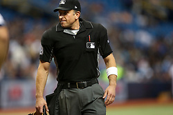 August 19, 2017 - St. Petersburg, Florida, U.S. - WILL VRAGOVIC   |   Times.Umpire Chris Guccione (68) wearing a white armband while officiating the game between the Seattle Mariners and the Tampa Bay Rays at Tropicana Field in St. Petersburg, Fla. on Saturday, Aug. 19, 2017. The World Umpires Association announced that umpires will be wearing white wristbands during all games to protest escalating verbal attacks on umpires and their strong objection to the Office of the Commissioner's response to the attacks. (Credit Image: © Will Vragovic/Tampa Bay Times via ZUMA Wire)
