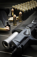 Beretta 9mm PX4 Storm semi-automatic pistol with magazine and full metal jacket ammunition on background of shooting target