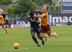 Dundee's Genseric Kusunga brings down Motherwell's Danny Johnson. Dundee 1 v 3 Motherwell, SPFL Ladbrokes Premiership game played 1/9/2018 at Dundee's Kilmac stadium Dens Park