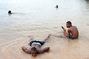 Boys play and swim in the sea next to the Fort Sao Sebastiao, Sao Tome <br /> Sao Tome and Principe, are two islands of volcanic origin lying off the coast of Africa. Settled by Portuguese convicts in the late 1400s and later a centre for slaving, their independence movement culminated in a peaceful transition to self government from Portugal in 1975.