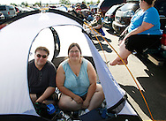 """Eric Ellis and wife Kim wait in a tent in line for an open casting session for season 11 of """"The Biggest Loser"""" television show in Broomfield, Colorado July 17, 2010. The couple said they wanted to lose weight on the show in the hope of having a second child, this time without expensive and difficult IVF they used for their first child. Over 600 people, many spending the night on the sidewalk outside the hall applied for a chance to be on the show and win $250,000.  REUTERS/Rick Wilking (UNITED STATES)"""