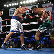 KISSIMMEE, FL - MARCH 06:  Jonathan Oquendo (L) and Gabino Cota fight for the WBO Latino Flyweight Title during the Telemundo Boxeo boxing match at the Kissimmee Civic Center on March 6, 2015 in Kissimmee, Florida. Oquendo won the belt after a 10 round unanimous decision on the scorecards. (Photo by Alex Menendez/Getty Images) *** Local Caption *** Jonathan Oquendo; Gabino Cota