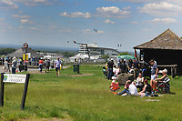 Horse Racing - Epsom Festival - Derby Day - Epsom Downs<br /> <br /> People wait for the racing at Tottenham corner with Fences closing off viewing to the public down to the main stand<br /> <br /> Credit : COLORSPORT/ANDREW COWIE