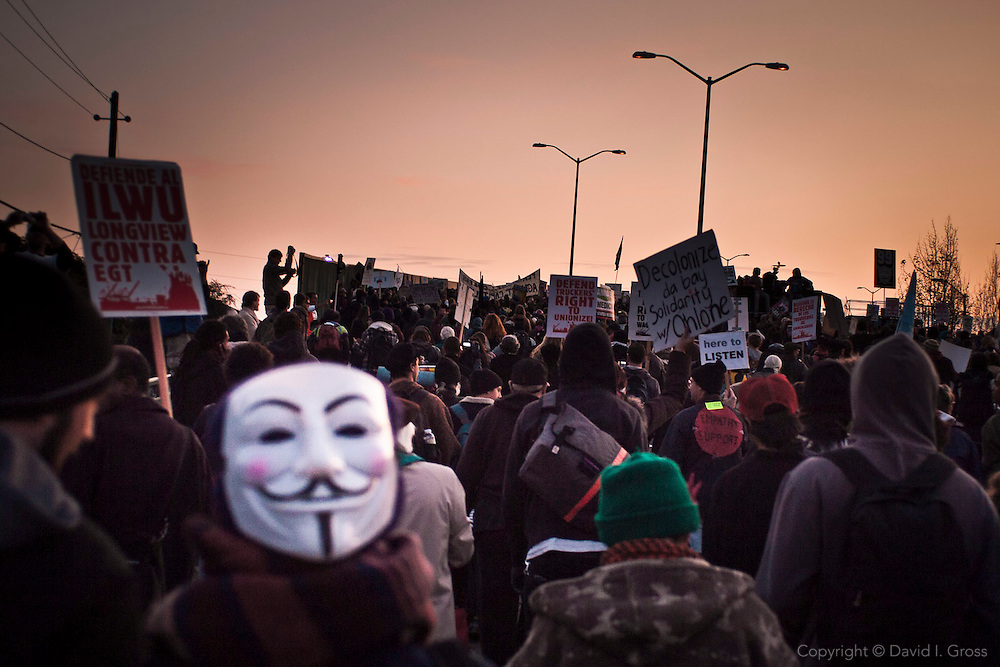 Protesters marched from downtown Oakland to the port at 3pm. The marchers blocked cargo trucks in Oakland, California, effectively shutting down parts of the port in the evening.