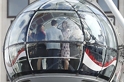 © Licensed to London News Pictures. 10/10/2016. London, UK.  CATHERINE, DUCHESS OF CAMBRIDGE, PRINCE WILLAM and PRINCE HARRY ride the London Eye ferris wheel.  Photo credit: Peter Macdiarmid/LNP