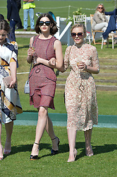 Left to right, SAI BENNET and CIARA CHARTERIS at the St.Regis International Polo Cup at Cowdray Park, Midhurst, West Sussex on 16th May 2015.