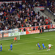 Thierry Henry, New York Red Bulls, (right) beats Montreal Impact goalkeeper Donovan Ricketts, to score the second of his hat trick of goals during the New York Red Bulls 5-2 win over Montreal Impact at Red Bulls Stadium, New York. USA. 31st March 2012. Photo Tim Clayton