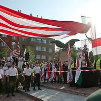 Flag weaves above participants during a political gathering of Hungarian far-right political party Jobbik to celebrate the fourth anniversary of their paramilitary group Hungarian Guard (or Magyar Garda in Hungarian) in Budapest, Hungary on August 28, 2011. ATTILA VOLGYI