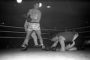 25/01/1963<br /> 01/25/1963<br /> 25 January 1963<br /> National Junior Boxing Championships at the National Stadium, Dublin. Picture shows M. Harris (left), St. Eugene's Boxing Club derry knocking down S. Irvine of Cooktown B.C., during the final of the Light/Heavyweight bout. Harris won to become Champion of 1963.