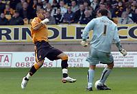Photo: Kevin Poolman.<br />Wolverhampton Wanderers v Colchester United. Coca Cola Championship. 14/10/2006. Craig Davies closes in on Colchester keeper Aidan Davison.