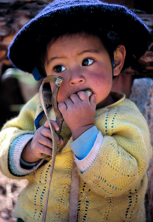 A young boy with a slingshot ponders the world in the Huaylas Valley in Peru.
