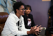 Marilyn Ruffin, left, speaks during their book club meeting in Sun Prairie, Wisconsin, Friday, Oct. 26, 2018.