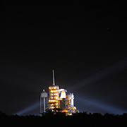 Shuttle Atlantis rests atop the launch pad at Kennedy Space Center Thursday, July 7, 2011, in Cape Canaveral, Fla. as workers finalize details for the morning launch. Shuttle Atlantis is scheduled to launch on Friday, July 8 and is the 135th and final space shuttle launch for NASA..  (AP Photo/Alex Menendez)