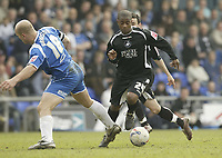 Photo: Aidan Ellis.<br /> Oldham Athletic v Swansea City. Coca Cola League 1. 22/04/2006.<br /> Swansea's Leon Knight takes on Oldham's Guy Branston