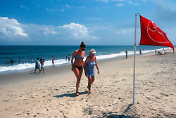 Mary Forsen, left, helps Molly Brown out of the waters of the Atlantic Ocean, at the Henlopen Acres Beach Club in Rehoboth Beach, Del., Friday, Aug. 16, 2019. (Photo by D. Ross Cameron)