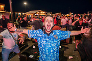 England fans celebrate winning the Euro 2020 semi final match between England and Denmark on the 7th of July 2021 at the outdoor screen at Folkestone Harbour Arm, in Folkestone, United Kingdom.