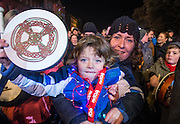 NO FEE PICTURES<br /> 31/12/15 Ethan Smith, age 5, Sandycove with his mum Tara at the NYF Bodhran Session World Record attempt at St Stephen's Green, part of the New Years Festival in Dublin. nyf.com running from 30th Dec to 1st Jan in Dublin. Picture: Arthur Carron