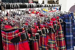 Row of kilts for sale in typical tourist gift shop on the Royal Mile in Edinburgh, Scotland, United Kingdom.