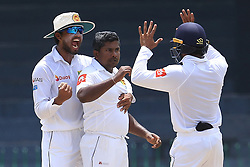 July 16, 2017 - Colombo, Sri Lanka - Sri Lanka's Rangana Herath(M) and capatain Dinesh Chandimal(L) celebrate taking the wicket of Zimbabwe's Hamilton Masakadza(unseen) during the third day's play of the only test cricket match between Sri Lanka and Zimbabwe at R Premadasa International cricket stadium, Colombo, Sri Lanka, Sunday, July 16, 2017  (Credit Image: © Tharaka Basnayaka/NurPhoto via ZUMA Press)