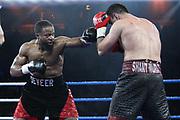 Boxen: Blitz & Donner, IBO Weltmeisterschaft, Halbschwergewicht,  Hamburg, 24.03.2018<br /> Karo Murat (GER) - Travis Reeves (USA)<br /> © Torsten Helmke