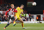 Brentford midfielder Ryan Woods gets the ball clear after a  well defended corner during the Sky Bet Championship match between Brentford and Rotherham United at Griffin Park, London, England on 17 October 2015. Photo by Andy Walter.